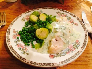 Cod fillet with white sauce.